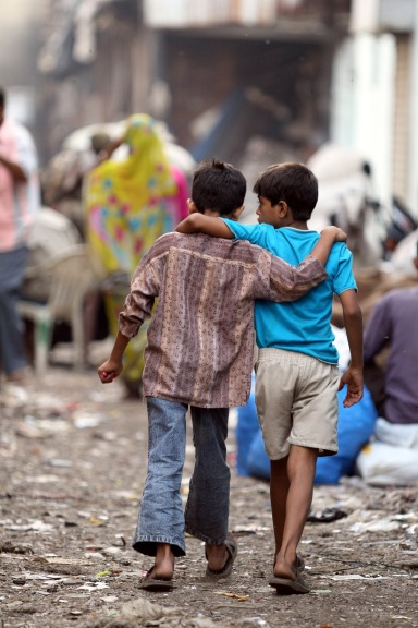 Young friends walking through Dharavi